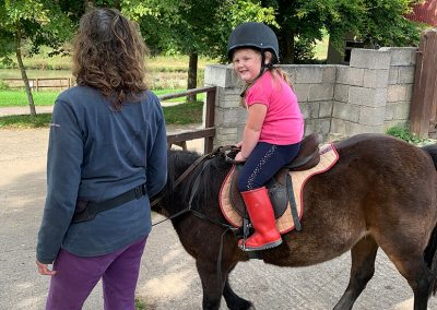 Young children horse riding